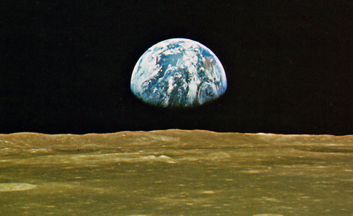 Viewed from the distance of the moon, the astonishing thing about the earth, catching the breath, is that it is alive. The photographs show the dry, pounded surface of the moon in the foreground, dead as an old bone. Aloft, floating free beneath the moist, gleaming membrane of the bright blue sky, is the rising earth, the only exuberant thing in this part of the cosmos. If you could look long enough, you would see the swirling of the great drifts of white cloud, covering and uncovering the half-hidden masses of land. If you had been looking a very long, geologic time, you could have seen the continents themselves in motion, drifting apart on their crustal plates, held aloft by the fire beneath. It has the organized, self-contained look of a live creature, full of information, marvelously skilled in handling the sun. —Lewis Thomas, The Lives of a Cell